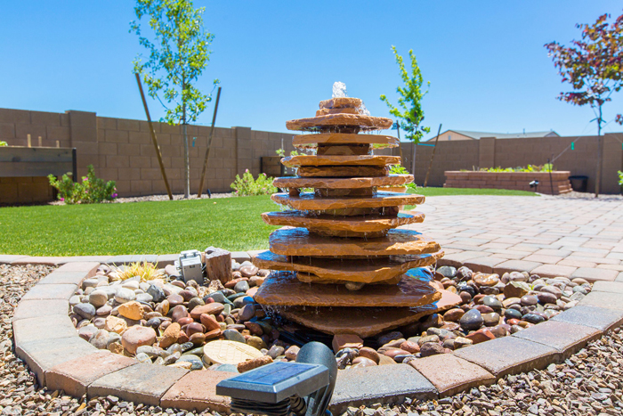 A layered rock fountain gives you the sound and beauty to enhance any yard.