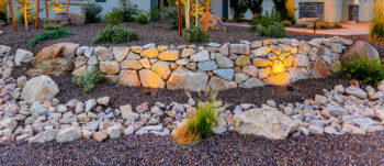 Unique Rock Walls and Paths can enhance your yard.
