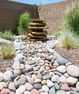 Create a rock river to your gorgeous fountain.